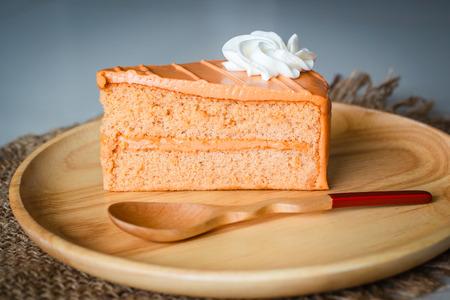 layer style: Thai tea layer cake on wood plate, style thai cake.
