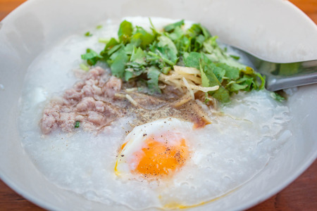 porridge with pork and egg, traditional chinese.