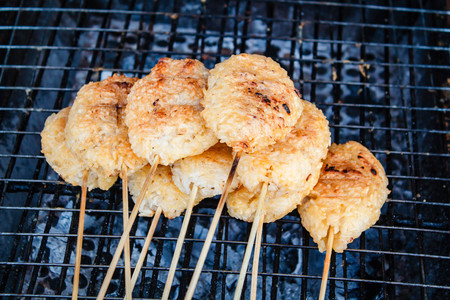 northeastern: Kao Ji, grilled sticky rice dipped in egg, region food of northeastern Thailand.