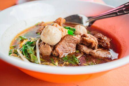 breakfast with meat Ekaehla ( KaoLau), food thai style. Stock Photo
