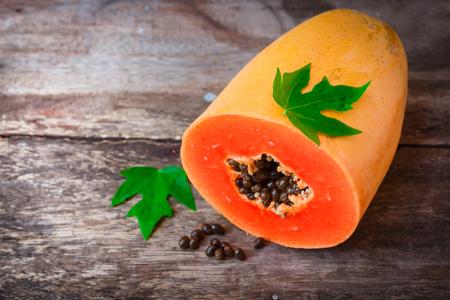 Ripe papaya on old wooden background, fruit asia.