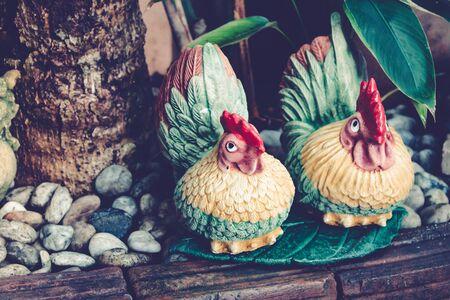 cray: Dolls for garden decoration, couple chicken. Stock Photo