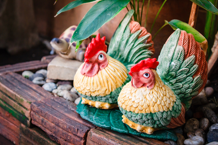 Dolls for garden decoration, couple chicken. Stock Photo