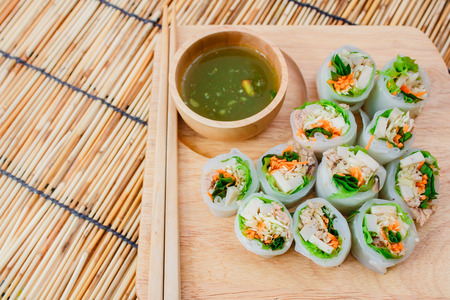 dipping: Fresh vegetable noodle spring roll with spicy sauce, thai style. Stock Photo