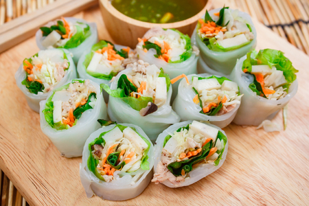 cut paper: Fresh vegetable noodle spring roll with spicy sauce, thai style. Stock Photo