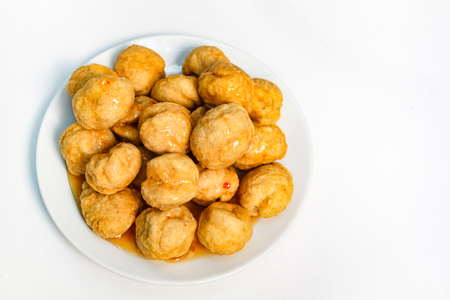 Fried fishballs and sweet sauce, street style. Stock Photo