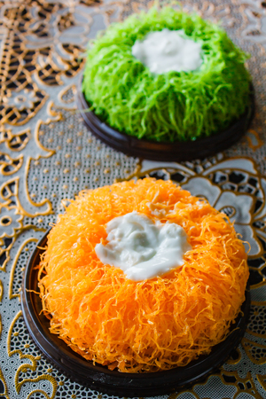 Gold Egg Yolk Thread Cakes or Cake Foi Tong Lava Cake, Thai cake. Stock Photo