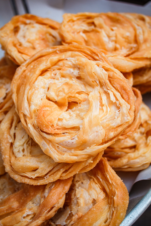 Stack of fried crispy roti at street food, thai style. Banco de Imagens