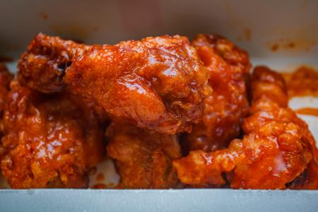 Fried chicken wings, street foods. Banco de Imagens