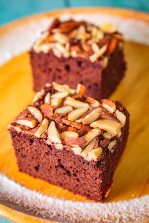 Homemade brownie cake decorated with almond and chocolate. Banco de Imagens