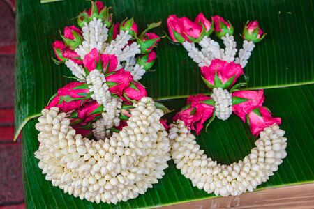 Thai style flower garland made of jasmine, marigold, crown flower and rose.