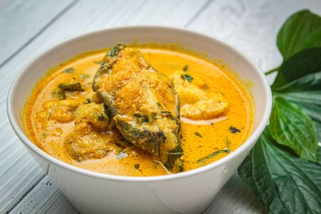 Delicious fried spicy catfish with red curry in thai food.