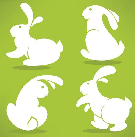 silhouette lapin: Lapins de P�ques silhouettes sur fond vert