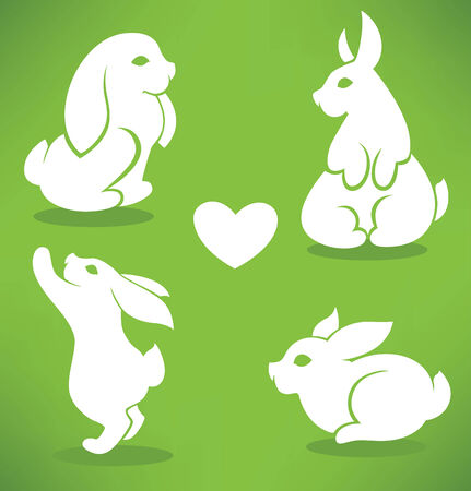 rabbit ears: Easter rabbits silhouettes on green background