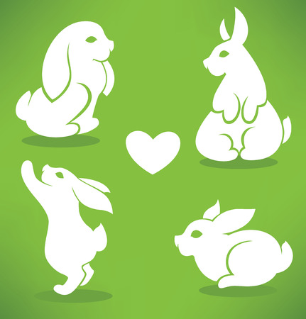 Easter rabbits silhouettes on green background Vector