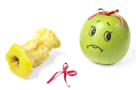 comically: apples with comically painted faces on a white background Stock Photo