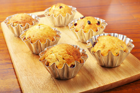Baking cupcakes with raisins in baskets photo