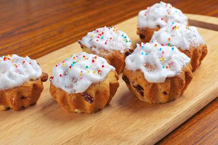 Baking cupcakes with raisins on the chalkboard photo