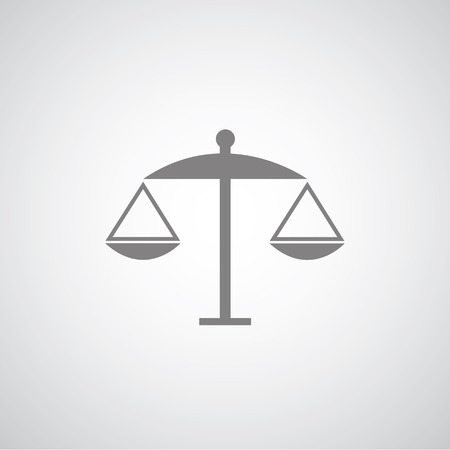 delinquency: scales of justice on gray background