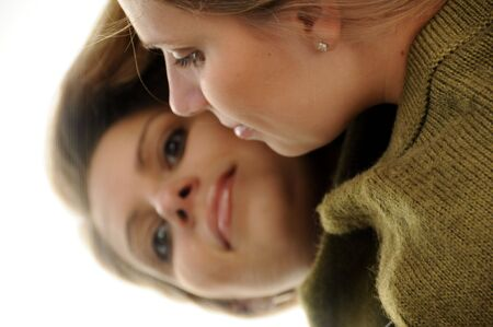 reflection: An adult female is casting her reflection in a mirror. Stock Photo