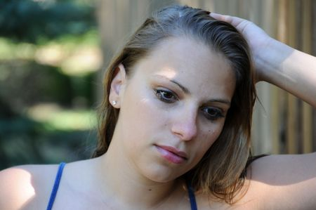 An adult female with a serious, sad look.