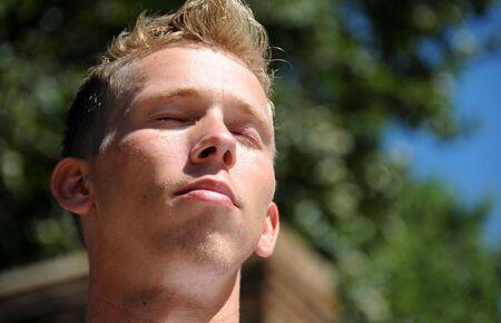 An adult male enjoys a warm summer day.