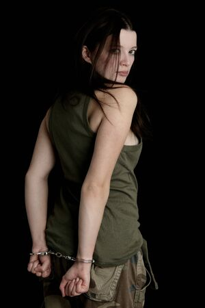 handcuffs woman: Model as a military girl in handcuffs Stock Photo
