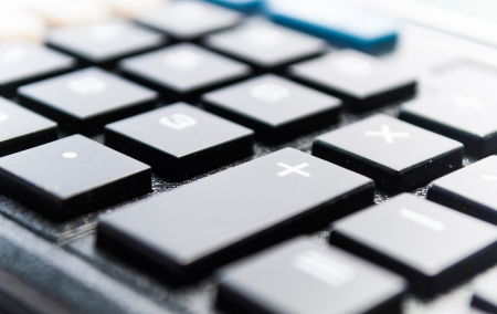 Calculator keys with focus on plus photo