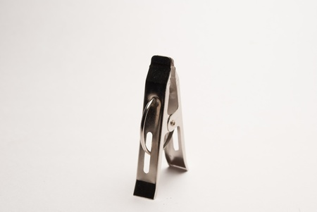 A metal clip on white background photo