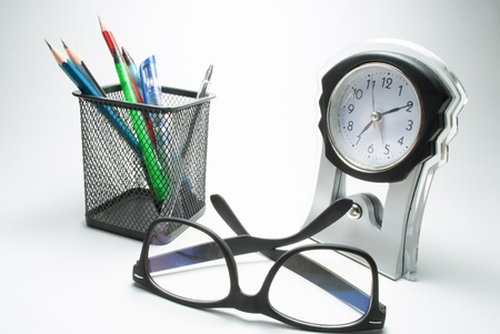 corrective: glasses table clock and pen stand Stock Photo