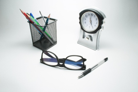 glasses table clock and pen stand photo