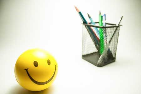 smiley ball and pen stand  photo