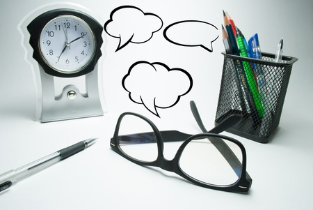 formal dressing: glasses table clock and pen stand with comment boxes Stock Photo
