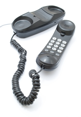 Gray office telephone isolated on a white background photo