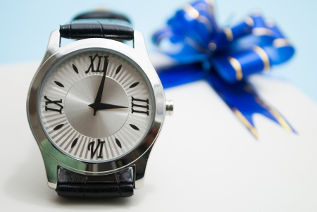 a gift box and a watch over it photo