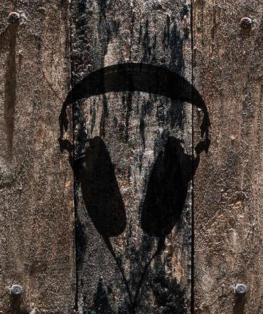 headphones design on grunge wood background photo