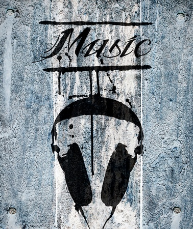 headphones design on grunge wood background photo