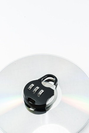compact disk with a security lock on it conceptual isolated image