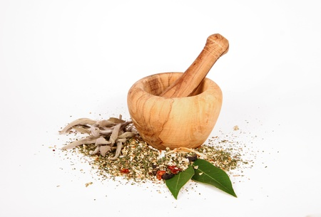 dried herbs: Spice grinder with dry spices on white background