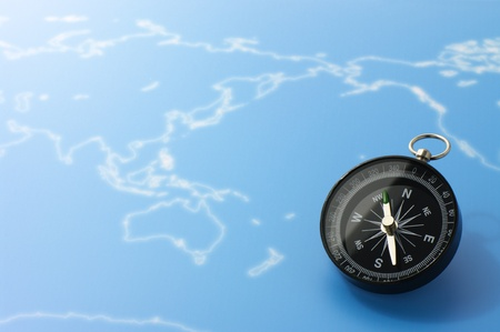 Compass on blue world map(Pacific Ocean). photo
