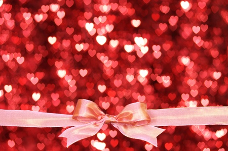 Pink ribbon and heart shaped blurry pattern background. photo