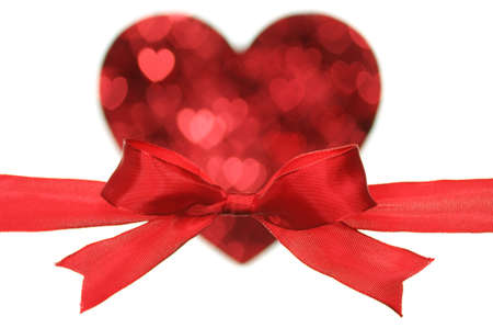 Red ribbon and heart shaped blurry pattern. Stock Photo - 12411593