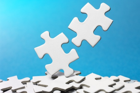 Trying to fit two jigsaw puzzle pieces  horizontal  Stock Photo - 13105327