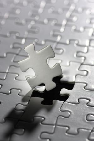 垂直方向の照らされたパズルのピース 写真素材