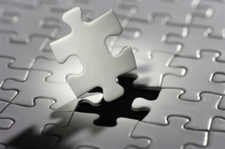 Puzzle piece in spot light Stock Photo - 14216863