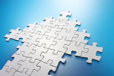 Arrow shaped jigsaw puzzle  Stockfoto