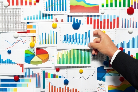 bar magnet: Businessman choosing from a variety of graphs  Stock Photo