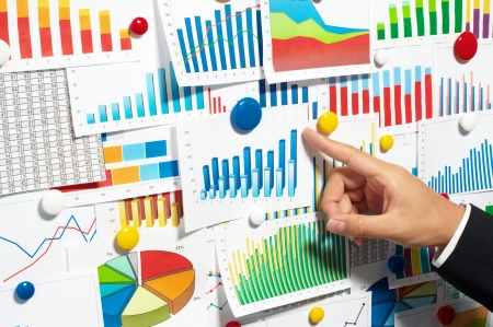 bar magnet: Businessman pointing out a graph