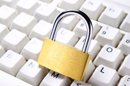 Protected communication  Close up of padlock on keyboard  photo
