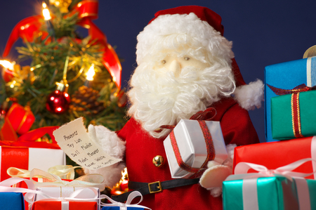 plushie: Stuffed toy Santa Claus, many colorful presents and Christmas tree